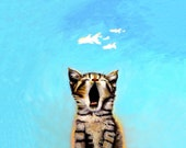 Fishful Thinking is both a realistic painting of a cat yawning with fantasy fish clouds above cat head