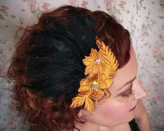 Black feather hairpiece with yellow vintage detail
