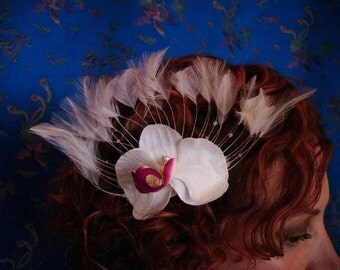 orchid and feather hairpiece with vintage gem
