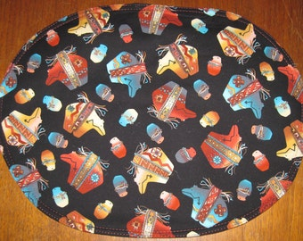 Oval placemats with American Indian bear fetish motif, set of 4