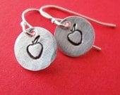 hand stamped silver apple earrings