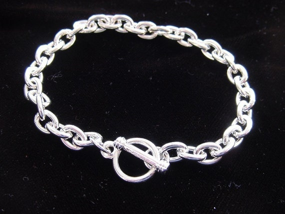 7.5 Inch Sterling Silver Plated Charm Bracelet (No. ND 134)