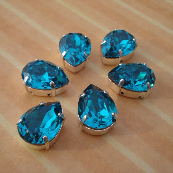 Swarovski 15x11mm Zircon/Teal  Blue Pear/Teardrop Gold Foiled Pointed Back Faceted Jewels set in Silver Plated SEW ON Settings (4 pieces)