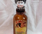 Vintage Bisque Doll Head on Vintage Langtry Balm Glass Jar