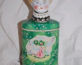 Vintage Bisque Dollhead on April Showers Talc Tin