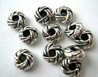 Antique Silver Spacers,7x3mm. Pkg of 24...R004 - - - SALE
