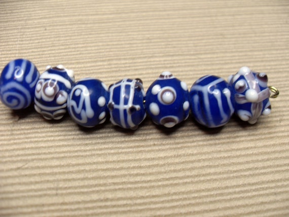 Lampwork,bright blues with light brown, opaque assortment 7 pieces.