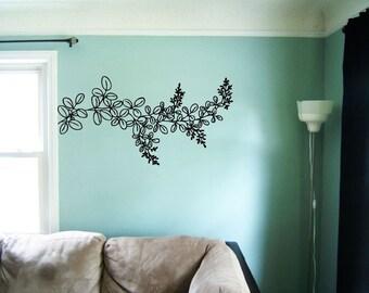 Leafy branch vinyl wall decal