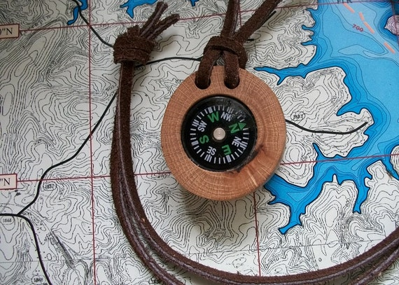 Compass and natural oak tree branch.  Perfect for hikers, hunters, campers, boy scout, girl scouts etc.  Handcrafted....70