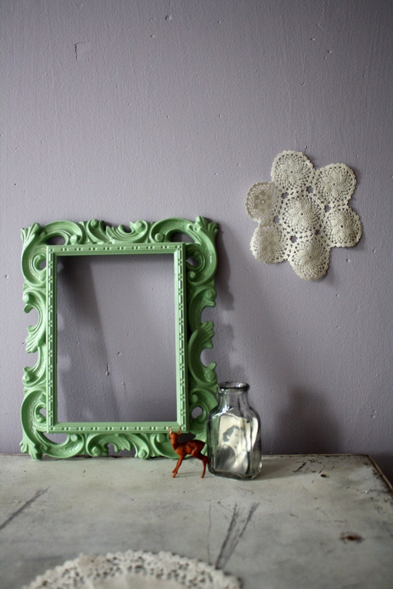 vintage. mint green. filigree frame.