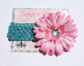 Turquoise crochet headband with pink daisy
