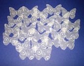 25 butterfly shaped swirl design velum punch-outs