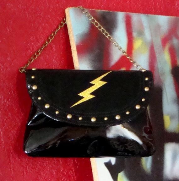 Retro Glam Rock Clutch Purse . Gold Glitter Lightning Bolt and Studs on Shiny Black Handbag