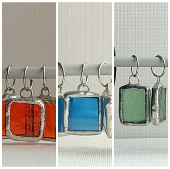 A mix set of 6 stitch markers in orange, blue and sea foam green glass