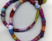 Long textile and felt necklace