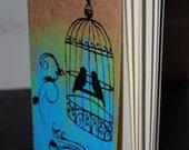 Moleskine journal with birdcage and swirl