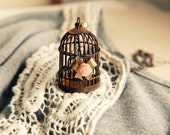 Dreams Kept. Whimsical bird cage and bow necklace. limited edition. . only 5 left for sale