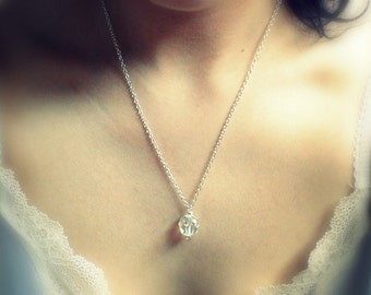 Innocent. A light capturing single crystal necklace. Only one in stock. More to come.
