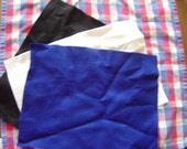 3 pieces of felt, black, white and blue