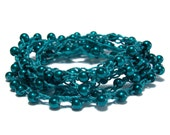 Long and versatile 42 inch crochet necklace in Teal with Teal color glass pearls