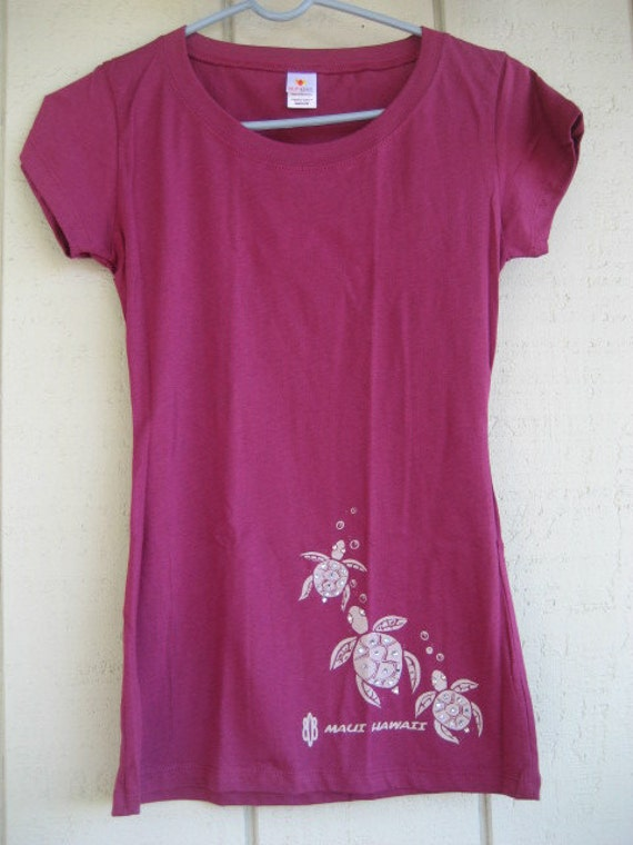 Maui-designed, hand-embellished, plum preshrunk, French cut ladies-tee with Swarovski crystals