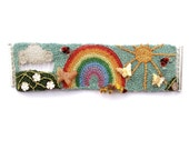 Crochet rainbow bracelet with flowers, butterfly's and ladybugs
