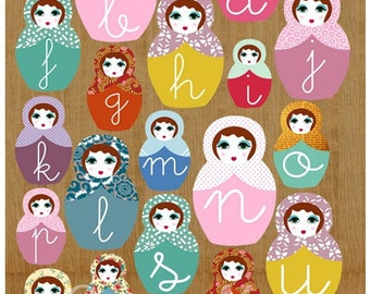 Learn ABC with cute russian dolls on wooden background