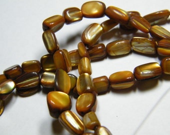 15 inch strand mother of pearl small pebble beads, dyed golden brown, supplies