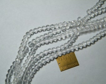 Glass beads: 11 inch strand of round 6mm clear glass beads, supplies