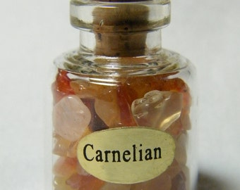 Bottle: 1 small glass bottle of Carnelian chips with a natural cork