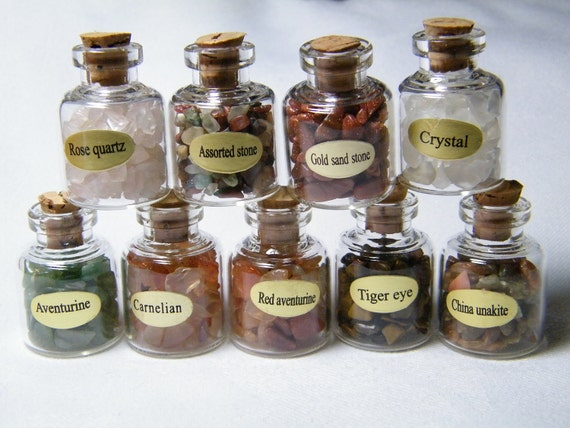 Bottles: Box of 9 small glass bottles of various chips with a natural cork