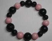 Stretch Bracelet Genuine Pink Coral and Black Lava Bead Bracelet