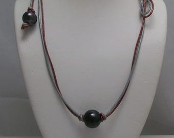 Black Pearls on Silver and metallic Red  Leather with toggle clasp