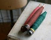 vintage wood spools with yarn