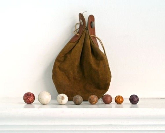 antique clay marbles and suede drawstring pouch