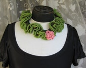 Knitted ruffles necklace with pink knitted flower