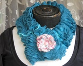 Two-sided turquoise ruffles neckwarmer with knitted flower