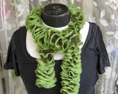 Knitted ruffles scarf in green shades