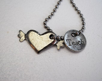 Teach and heart with wings Necklace