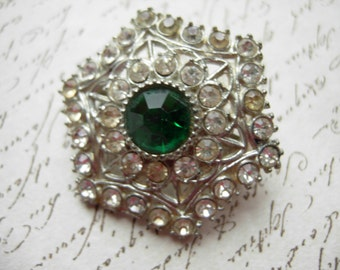 vintage brooch with faux emerald stone