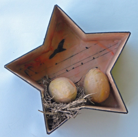 Decorative star birdhouse with nest and eggs
