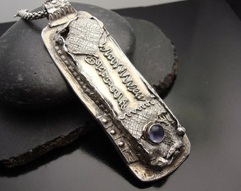 The Fifth Element - Fine Silver and Iolite Pendant