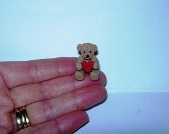 Dolls house miniature teddy bear holding love heart