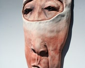 The Diver, Face, hanging wall sculpture