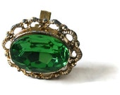 Big bold emerald green cocktail ring with gold filigree adjustable band