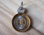 Set within steampunk pendant