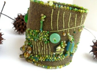 Fragments in green cuff, fiber art bead embroidery green free style embroidery, hand stitched, bohemian, Coachella, romantic, statement