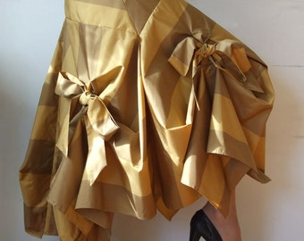 Glamorous taffeta skirt in antique gold draped with bows