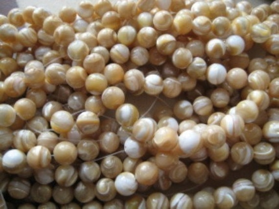 100 Mother of Pearl  7.5 mm