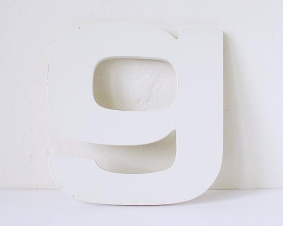 Vintage lowercase white letter G, sans serif
